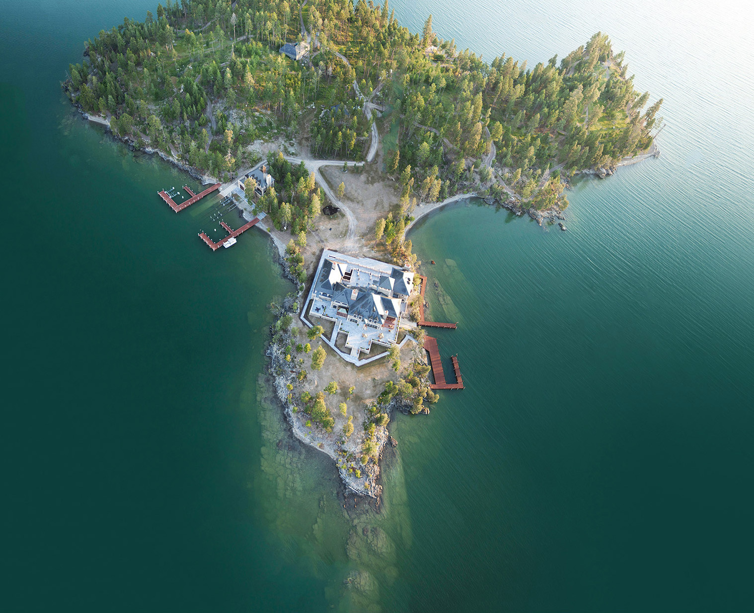 Nestquest tour stunning stone mansion on private island for Shelter island montana